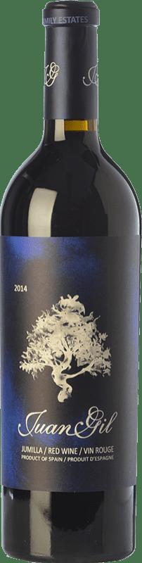 25,95 € Spedizione Gratuita | Vino rosso Juan Gil Etiqueta Azul Crianza D.O. Jumilla Castilla-La Mancha Spagna Syrah, Cabernet Sauvignon, Monastrell Bottiglia 75 cl